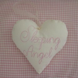 sleeping angel lettering padded heart hanging ornament made in the machine embroidery hoop lavender filled linen heart needle passion embroidery npe