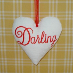 darling lettering padded heart hanging ornament made in the machine embroidery hoop lavender filled linen heart needle passion embroidery npe
