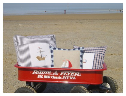 radio flyer wagon on a beach filled with seaside cushions machine embroidery nautical maritime seaside beach sea swimming fishing design art pes hus dst needle passion embroidery npe